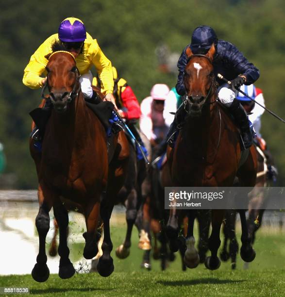 Mick Kinane and Sea The Stars get the better of the Jimmy Fortune ridden Rip Van Winkle to land The Coral Eclipse Race run at Sandown Park on July 4...