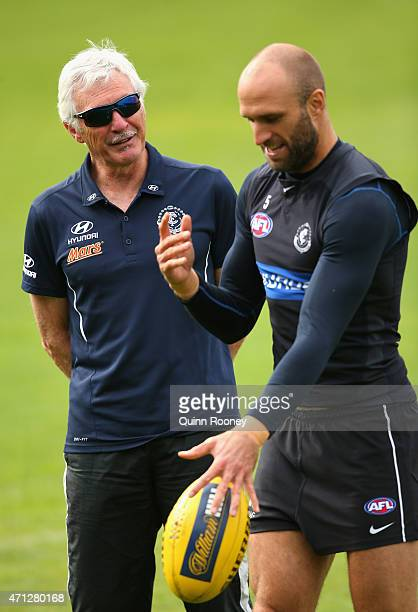 Mick Malthouse the coach of the Blues talks to Chris Judd during a Carlton Blues AFL media session at Ikon Park on April 27 2015 in Melbourne...
