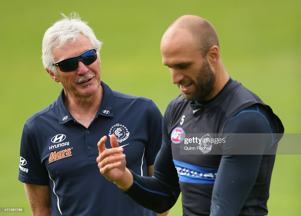 Mick Malthouse the coach of the Blues talks to Chris Judd during a Carlton Blues AFL media session at Ikon Park on April 27, 2015 in Melbourne, Australia.