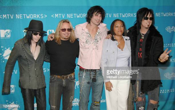 Mick Mars Vince Neil Tommy Lee and Nikki Sixx of Motley Crue with Christina Norman VH1 President