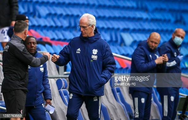 Mick McCarthy, Manager of Cardiff City and Paul Warne of Rotherham United during the Sky Bet Championship match between Cardiff City and Rotherham...