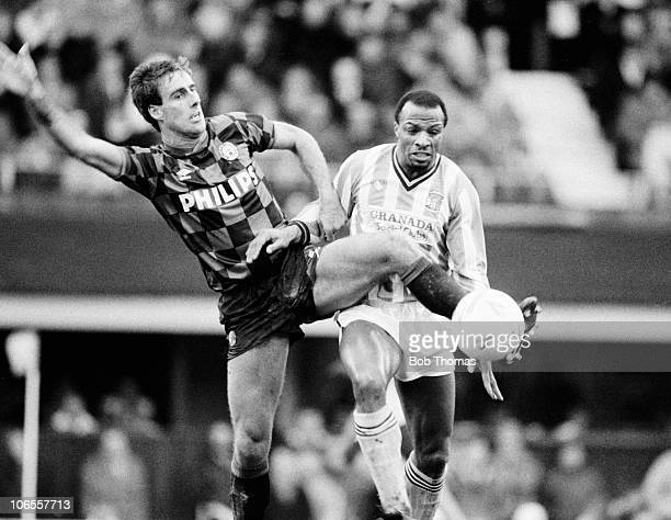 Mick McCarthy of Manchester City clashes with Cyrille Regis of Coventry City during the Coventry City v Manchester City Division 1 match played at...