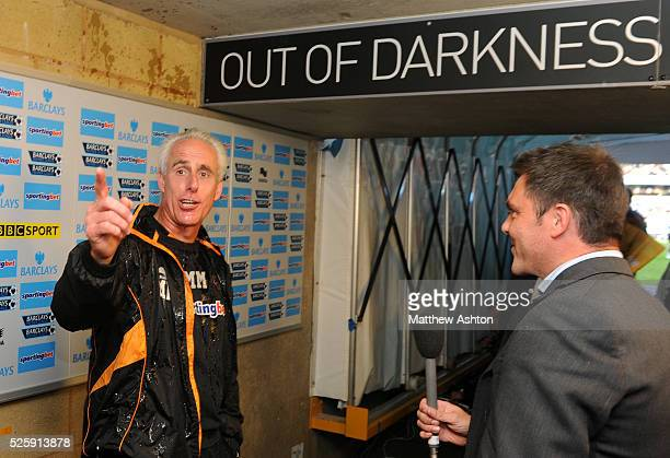 Mick McCarthy the manager / head coach of Wolverhampton Wanderers smiles after being drenched with water by George Elokobi of Wolverhampton Wanderers...