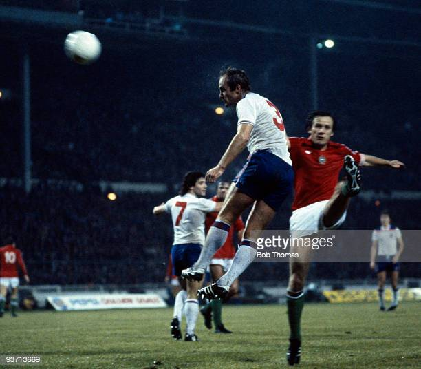 Mick Mills of England outjumps Gyozo Martos of Hungary during the England v Hungary World Cup qualifying match held at Wembley Stadium London on the...