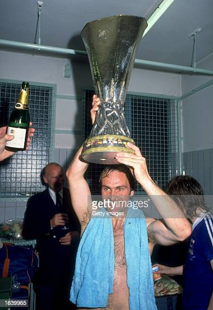 Mick Mills of Ipswich Town holds the UEFA Cup aloft after their victory in the UEFA Cup final against AZ 67 Alkmaar at the Olympic Stadium in...