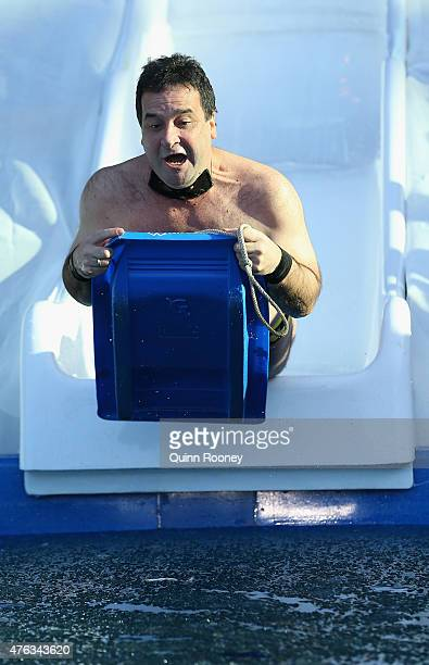 Mick Molloy dives into an icebath to raise money for Motor Neurone Disease ahead of the round 10 AFL match between the Melbourne Demons and the...