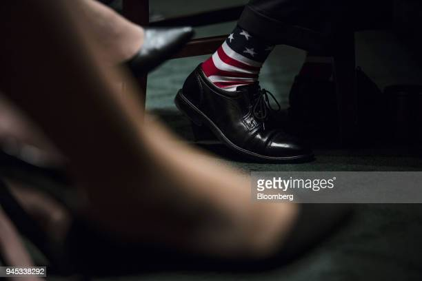 Mick Mulvaney acting director of the Consumer Financial Protection Bureau wears American flag themed socks during a Senate Banking Housing Urban...