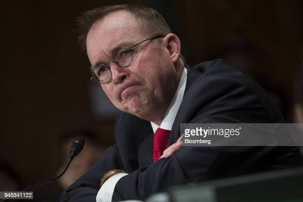 Mick Mulvaney acting director of the Consumer Financial Protection Bureau listens during a Senate Banking Housing Urban Affairs Committee hearing in...