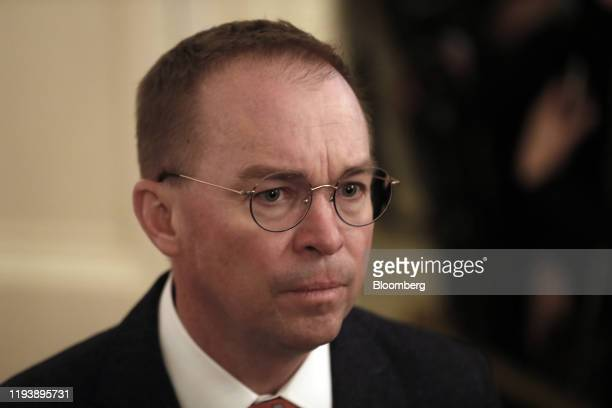 Mick Mulvaney acting White House chief of staff arrives for a signing ceremony for the USChina phaseone trade agreement in Washington DC US on...