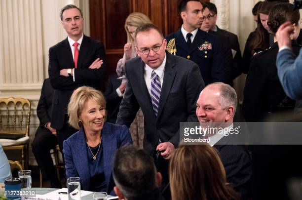 Mick Mulvaney acting White House chief of staff center speaks to John Bel Edwards governor of Louisiana right and Betsy DeVos US secretary of...