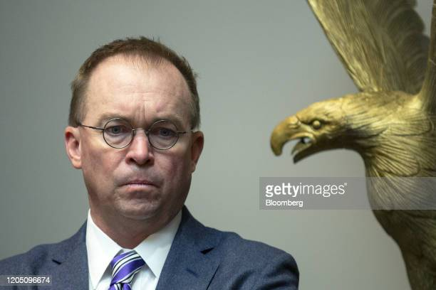 Mick Mulvaney acting White House chief of staff listens during a briefing with airline executives at the White House in Washington DC US on Wednesday...