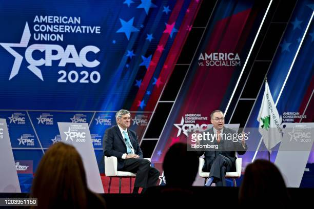 Mick Mulvaney acting White House chief of staff speaks as Stephen Moore visiting fellow at the Heritage Foundation left listens during a discussion...