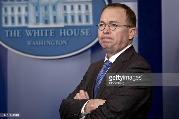 Mick Mulvaney director of the Office of Management and Budget listens during a press briefing at the White House in Washington DC US on Friday Jan 19...