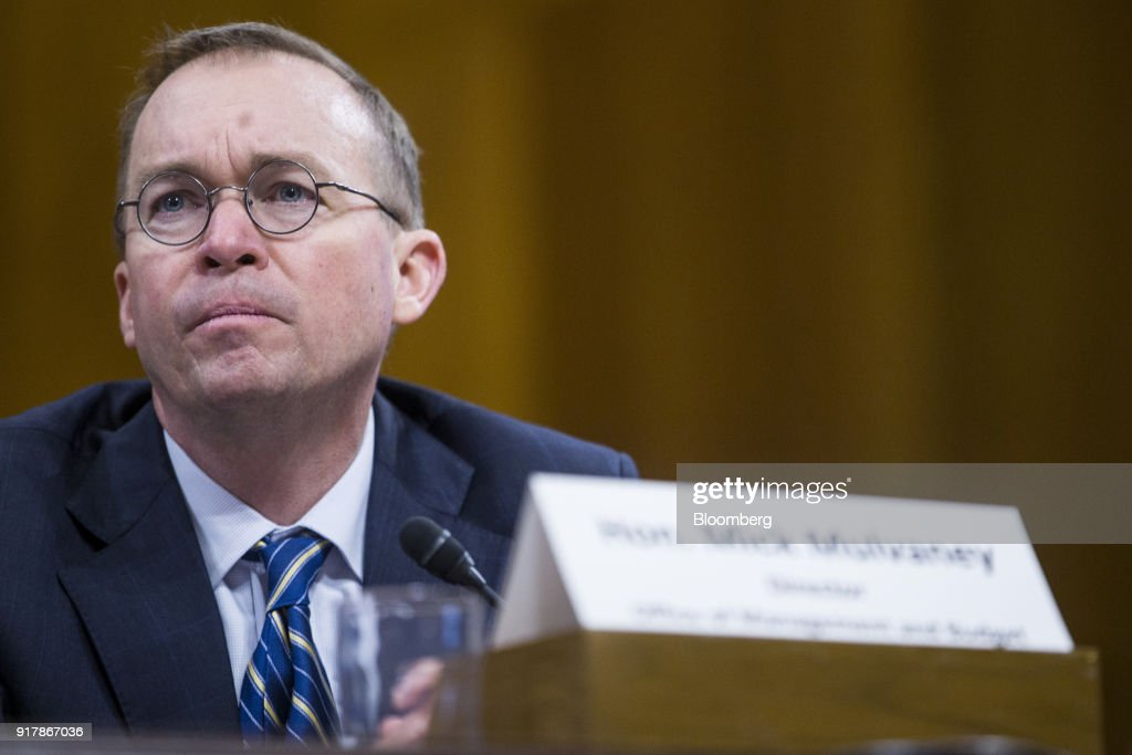 Mick Mulvaney, director of the Office of Management and Budget (OMB), listens during a Senate Budget Committee hearing in Washington, D.C., U.S., on Tuesday, Feb. 13, 2018. Mulvaney discussed the $4.4 trillion federal budget plan that would slash entitlements and other domestic programs in favor of higher spending on the military and immigration enforcement. Photographer: Zach Gibson/Bloomberg via Getty Images