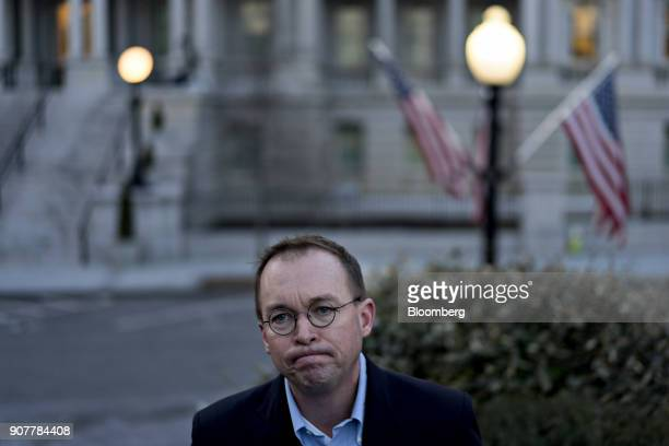 Mick Mulvaney director of the Office of Management and Budget pauses while speaking to members of the media outside the White House in Washington DC...
