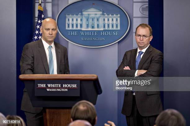 Mick Mulvaney director of the Office of Management and Budget right and Marc Short White House director of legislative affairs listen to a question...