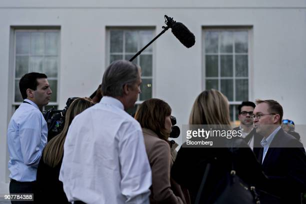 Mick Mulvaney director of the Office of Management and Budget right speaks to members of the media outside the White House in Washington DC US on...