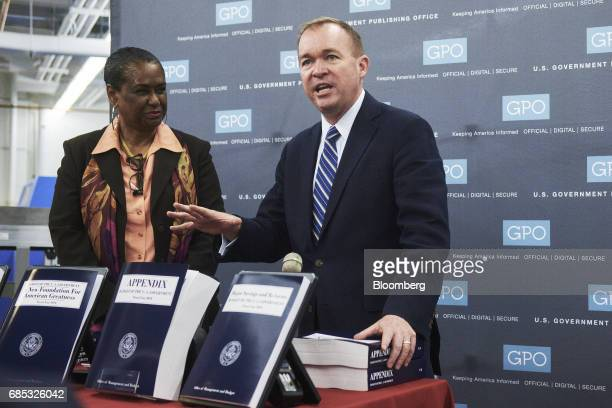 Mick Mulvaney director of the US Office of Management and Budget right speaks as Davita VanceCooks director of the Government Publishing Office...