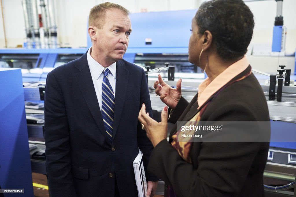 Mick Mulvaney, director of the U.S. Office of Management and Budget, left, speaks with Davita Vance-Cooks, director of the Government Publishing Office (GPO), during a tour of the GPO production facility in Washington, D.C., U.S., on Friday, May 19, 2017. PresidentDonald Trumpwill send to Congress on Tuesday a proposal for balancing the federal budget within 10 years through deep cuts to discretionary and safety net spending, according to a U.S. official. Photographer: T.J. Kirkpatrick/Bloomberg via Getty Images
