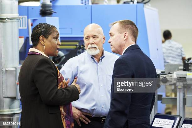 Mick Mulvaney director of the US Office of Management and Budget right speaks with Davita VanceCooks director of the Government Publishing Office...