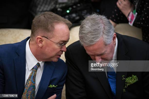 Mick Mulvaney former acting White House chief of staff left speaks with Mark Meadows incoming White House chief of staff during a meeting with US...