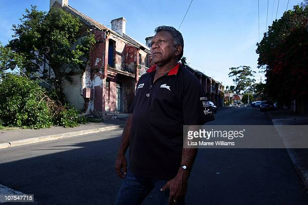"""Mick Mundine Chief Executive of the Aboriginal Housing Company stands on Louis Street in the Aboriginal housing community known as """"The Block"""" in..."""