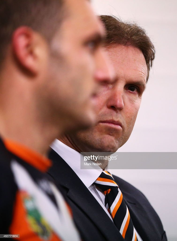 Mick Potter and Robbie Farah of the Tigers talk to the media after the round 20 NRL match between the Wests Tigers and the St George Illawarra Dragons at ANZ Stadium on July 27, 2014 in Sydney, Australia.