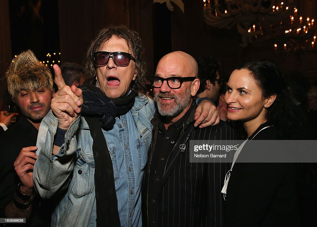 Mick Rock, Michael Stipe and Rain Phoenix attend The Lunchbox Fund