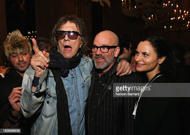 Mick Rock Michael Stipe and Rain Phoenix attend The Lunchbox Fund Fall Fête at Buddakan New York on October 9 2013 in New York City