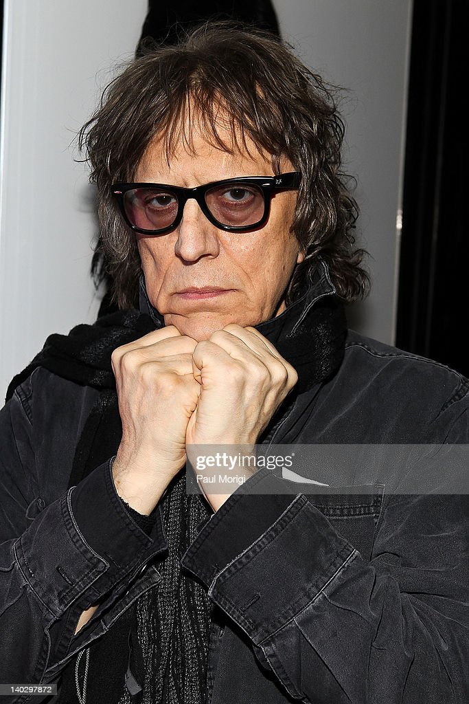 Mick Rock poses for a photo at Mick Rock's Photography exhibit at the W Washington D.C. on March 1, 2012 in Washington, DC.