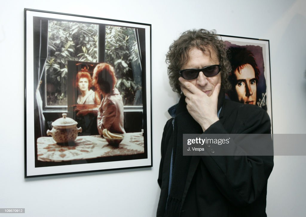 Mick Rock with his portraits of David Bowie and John Lydon