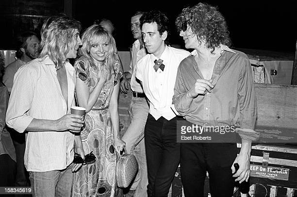 Mick Ronson Ellen Foley Mick Jones and Ian Hunter backstage at an Ian Hunter show in Central Park New York City on 11th July 1980