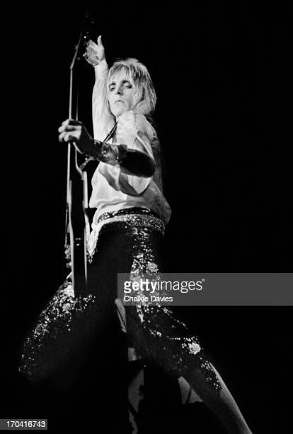 Mick Ronson performs on stage at Hammersmith Odeon on the last night of the Ziggy Stardust Tour, London, 3rd July 1973. At the end of the show David...