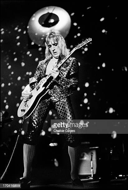 Mick Ronson performs on stage at Hammersmith Odeon on the last night of the Ziggy Stardust Tour London 3rd July 1973 At the end of the show David...