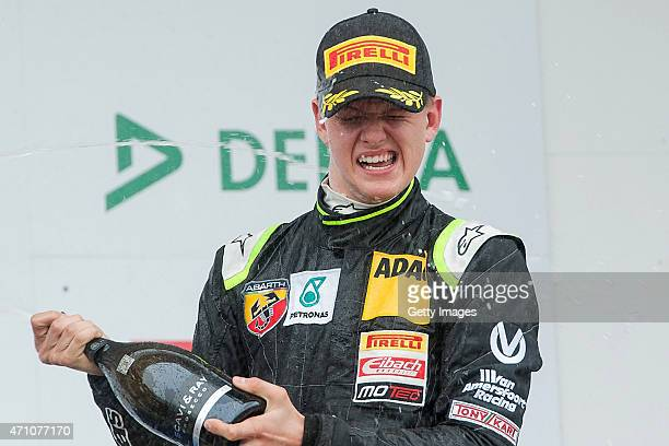 Mick Schumacher celebrates after winning the trophy for the best rookie of the ADAC Formula Four championship at Motorsport Arena Oschersleben on...