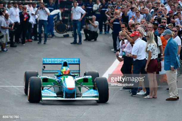 Mick Schumacher, German racing driver and son of seven-time Formula One champion Michael Schumacher, sits inside a Benetton B194 car before driving...