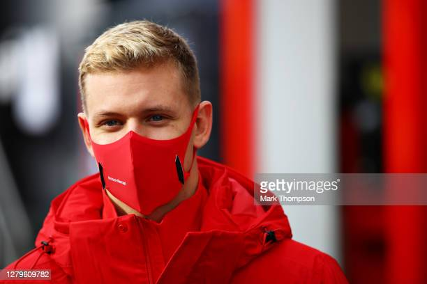 Mick Schumacher of Germany and Alfa Romeo Racing looks on in the Paddock before the F1 Eifel Grand Prix at Nuerburgring on October 11, 2020 in...