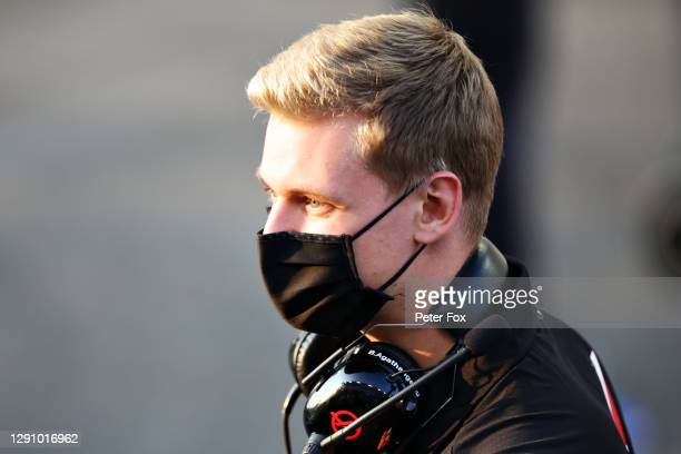 Mick Schumacher of Germany and Haas F1 looks on prior to the F1 Grand Prix of Abu Dhabi at Yas Marina Circuit on December 13, 2020 in Abu Dhabi,...