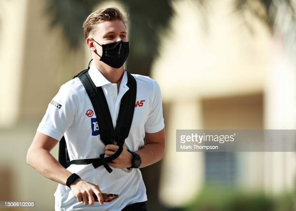 Mick Schumacher of Germany and Haas F1 runs in the Paddock during Day One of F1 Testing at Bahrain International Circuit on March 12, 2021 in...