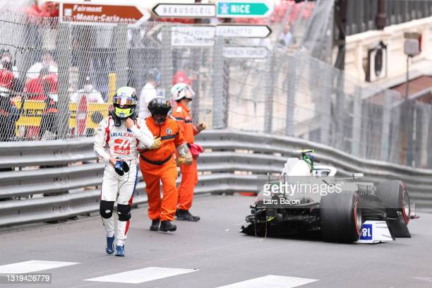Mick Schumacher of Germany and Haas F1 walks away from his car after crashing during final practice prior to the F1 Grand Prix of Monaco at Circuit...
