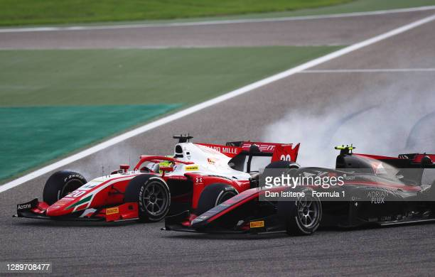 Mick Schumacher of Germany and Prema Racing and Callum Ilott of Great Britain and UNI-Virtuosi Racing battle for position during the Round 12:Sakhir...