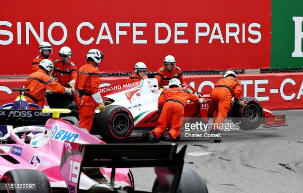 Mick Schumacher of Germany and Prema Racing is pushed from the circuit after stopping during the Formula 2 feature race at Circuit de Monaco on May...