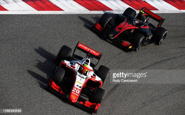 Mick Schumacher of Germany and Prema Racing leads Callum Ilott of Great Britain and UNI-Virtuosi Racing during the Round 11:Sakhir Sprint Race of the...