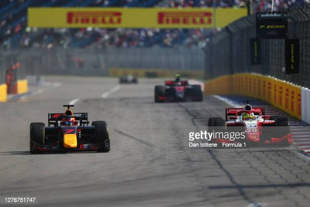 Mick Schumacher of Germany and Prema Racing overtakes Yuki Tsunoda of Japan and Carlin for the lead during the Formula 2 Championship Feature Race at...
