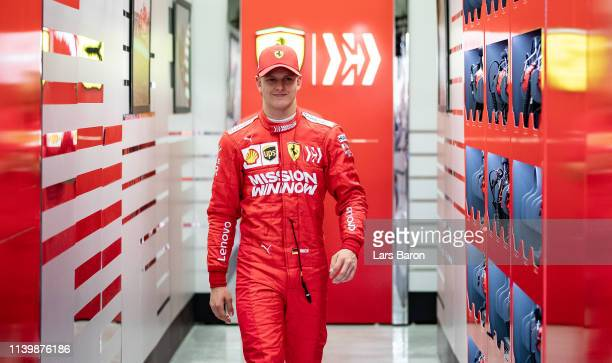 Mick Schumacher of Germany and Scuderia Ferrari SF90 walks out of the garage during F1 testing in Bahrain at Bahrain International Circuit on April...