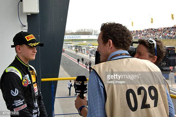 Mick Schumacher of Germany and Van Amersfoort Racing talks to the media after the the ADAC Formula 4 race one at Motorsport Arena Oschersleben on...