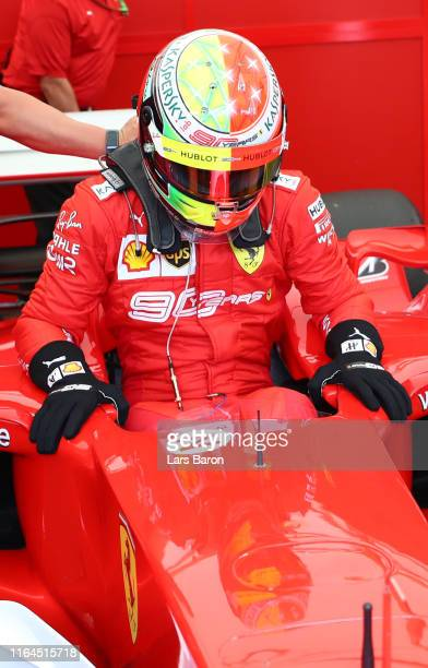 Mick Schumacher of Germany climbs from the Ferrari F2004 of his father Michael Schumacher after final practice for the F1 Grand Prix of Germany at...
