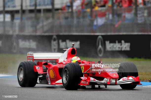 Mick Schumacher of Germany drives the Ferrari F2004 of his father Michael Schumacher before the F1 Grand Prix of Germany at Hockenheimring on July 28...