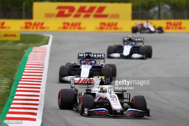 Mick Schumacher of Germany driving the Haas F1 Team VF-21 Ferrari ahead of George Russell of Great Britain driving the Williams Racing FW43B Mercedes...