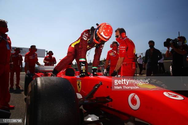 Mick Schumacher of Germany prepares to drive the Ferrari F2004 of his father Michael Schumacher before the F1 Grand Prix of Tuscany at Mugello...